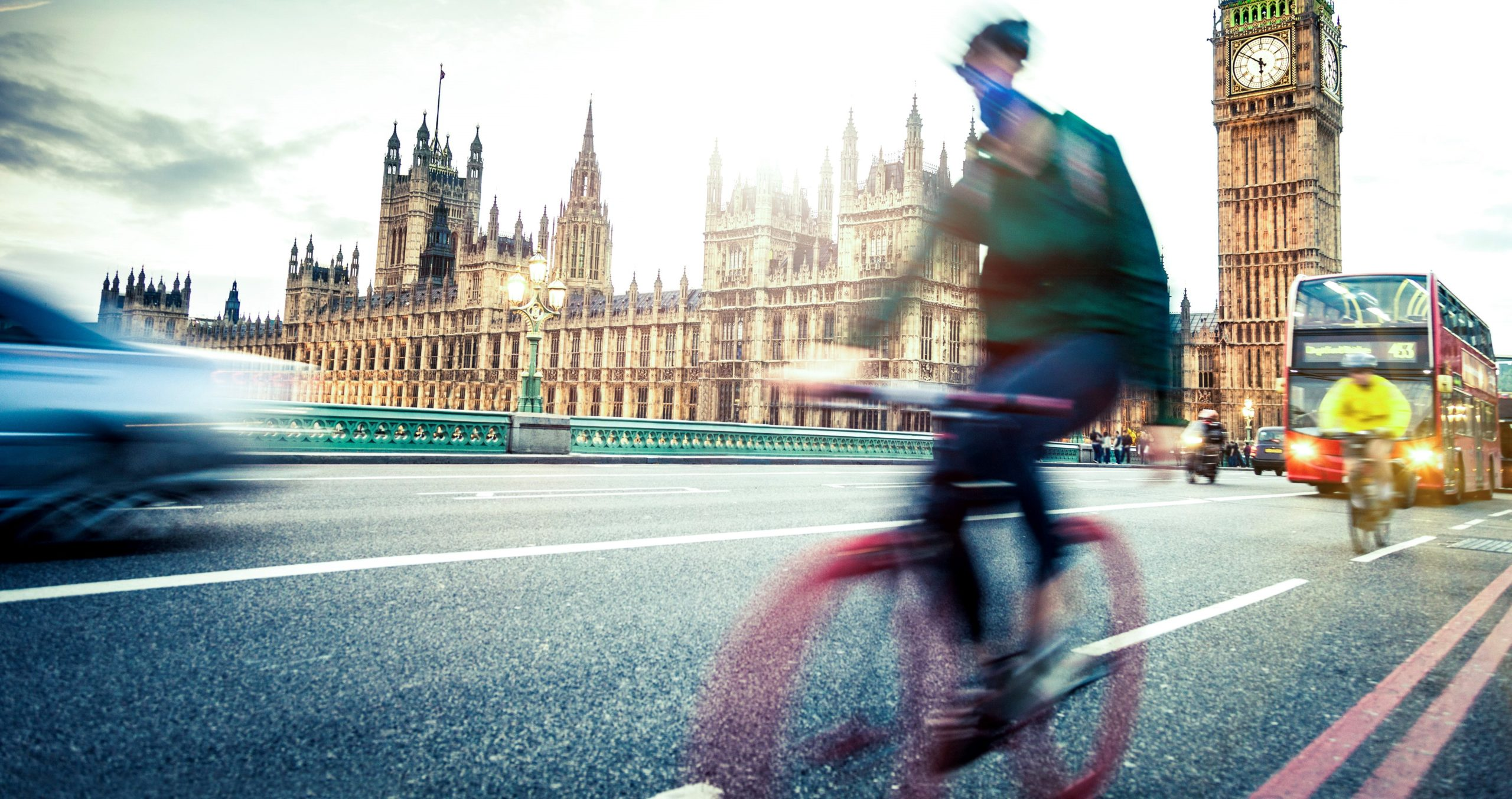 An image of people utilizing different commuting options in London, including cycling.